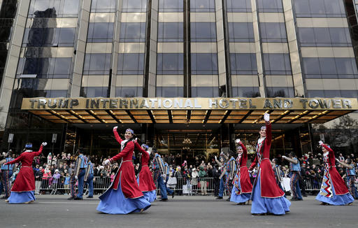 "<div class=""meta image-caption""><div class=""origin-logo origin-image none""><span>none</span></div><span class=""caption-text"">Sayat Nova Dance Company dancers wave to spectators as they walk past the Trump International Hotel and Tower during the Macy's Thanksgiving Day parade, Thursday, Nov. 24, 2016. (AP Photo/Julie Jacobson)</span></div>"