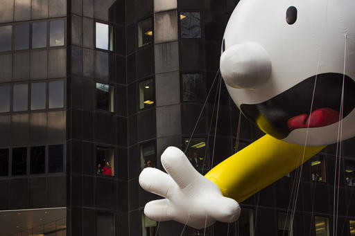 "<div class=""meta image-caption""><div class=""origin-logo origin-image none""><span>none</span></div><span class=""caption-text"">People watch as the Diary of a Wimpy Kid balloon makes its way across Sixth Avenue during the Macy's Thanksgiving Day Parade, in New York, Thursday, Nov. 24, 2016. (AP Photo/Andres Kudacki)</span></div>"