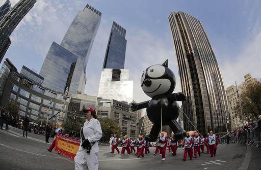 "<div class=""meta image-caption""><div class=""origin-logo origin-image none""><span>none</span></div><span class=""caption-text"">The Felix the Cat balloon is guided through Columbus Circle during the Macy's Thanksgiving Day parade, Thursday, Nov. 24, 2016, in New York. (AP Photo/Julie Jacobson)</span></div>"