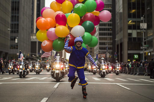 "<div class=""meta image-caption""><div class=""origin-logo origin-image none""><span>none</span></div><span class=""caption-text"">A performer carries balloons across Sixth Avenue during the Macy's Thanksgiving Day Parade, in New York, Thursday, Nov. 24, 2016. (AP Photo/Andres Kudacki)</span></div>"