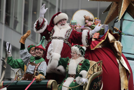 "<div class=""meta image-caption""><div class=""origin-logo origin-image none""><span>none</span></div><span class=""caption-text"">Santa Claus waves from his float as he passes along Sixth Avenue during the Macy's Thanksgiving Day parade, Thursday, Nov. 24, 2016, in New York. (AP Photo/Julie Jacobson)</span></div>"