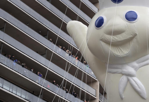 "<div class=""meta image-caption""><div class=""origin-logo origin-image none""><span>none</span></div><span class=""caption-text"">Spectators watch from balconies along Central Park South as the Pillsbury Doughboy balloon passes during the Macy's Thanksgiving Day parade, Thursday, Nov. 24, 2016, in New York. (AP Photo/Julie Jacobson)</span></div>"