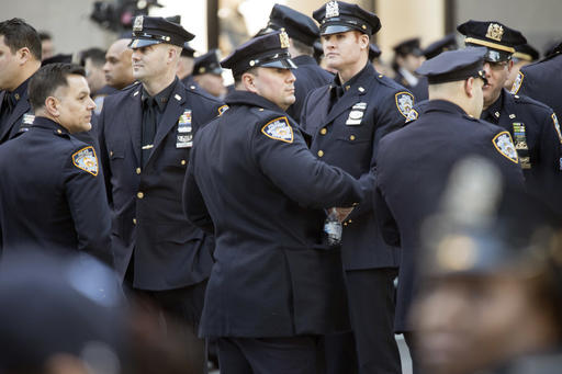 <div class='meta'><div class='origin-logo' data-origin='AP'></div><span class='caption-text' data-credit=''>New York City police officers assemble on Fifth Avenue the before the start of the funeral service.  (AP Photo/Mary Altaffer)</span></div>