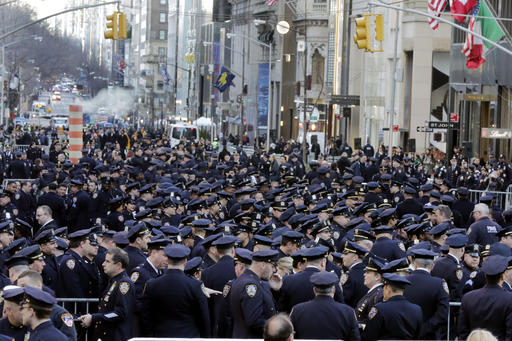 <div class='meta'><div class='origin-logo' data-origin='AP'></div><span class='caption-text' data-credit=''>Police officers fill New York's Fifth Avenue prior to the funeral for Steven McDonald at St. Patrick's Cathedral. (AP Photo/Richard Drew)</span></div>