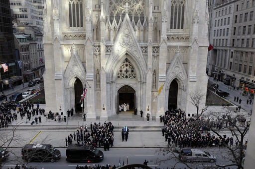 <div class='meta'><div class='origin-logo' data-origin='AP'></div><span class='caption-text' data-credit=''>NYPD Detective Steven McDonald 's casket arrives at St. Patrick's Cathedral for his funeral.  (AP Photo/Mark Lennihan)</span></div>