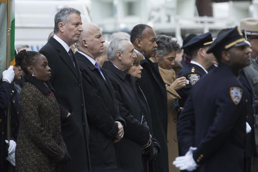 "<div class=""meta image-caption""><div class=""origin-logo origin-image ap""><span>AP</span></div><span class=""caption-text"">Mayor Bill de Blasio, his wife Chirlane McCray, left, NYPD Commissioner James P. O'Neill third from left, and former Police Commissioner William Bratton,  (AP Photo/Mary Altaffer)</span></div>"