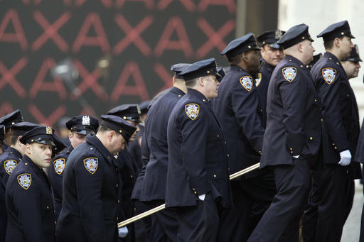 <div class='meta'><div class='origin-logo' data-origin='AP'></div><span class='caption-text' data-credit=''>Police officers enter St. Patrick's Cathedral for the funeral service for New York City police officer Steven McDonald, Friday, Jan. 13, 2017, in New York. (AP Photo/Mary Altaffer)</span></div>
