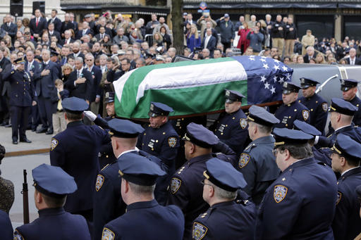 <div class='meta'><div class='origin-logo' data-origin='AP'></div><span class='caption-text' data-credit=''>The casket of New York City Police Dept. Detective Steven McDonald is carried into St. Patrick's Cathedral, in New York. (AP Photo/Richard Drew)</span></div>