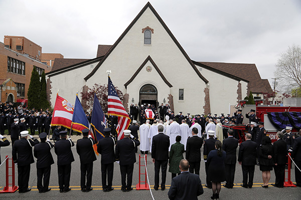 <div class='meta'><div class='origin-logo' data-origin='none'></div><span class='caption-text' data-credit='AP Photo/Seth Wenig'>William Tolley's casket is carried out of a church during his funeral in Bethpage, N.Y.</span></div>