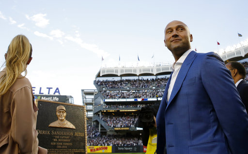 "<div class=""meta image-caption""><div class=""origin-logo origin-image ap""><span>AP</span></div><span class=""caption-text"">Retired Yankees shortstop Derek Jeter, right, looks around during a pregame ceremony after his No. 2 was retired in Monument Park at Yankee Stadium May 14, 2017 (Kathy Willens) (AP)</span></div>"