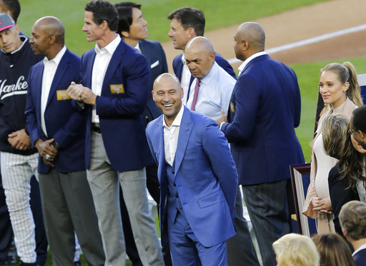 "<div class=""meta image-caption""><div class=""origin-logo origin-image ap""><span>AP</span></div><span class=""caption-text"">Former New York Yankees' Derek Jeter smiles during a ceremony retiring his number at Yankee Stadium, Sunday, May 14, 2017, in New York. (AP Photo/Seth Wenig) (AP)</span></div>"
