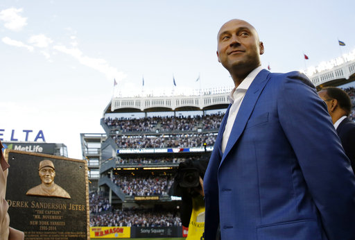"<div class=""meta image-caption""><div class=""origin-logo origin-image ap""><span>AP</span></div><span class=""caption-text"">Retired Yankees shortstop Derek Jeter, right, looks around during a pregame ceremony after his No. 2 was retired in Monument Park at Yankee Stadium May 14, 2017. (Kathy Willens) (AP)</span></div>"