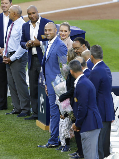 "<div class=""meta image-caption""><div class=""origin-logo origin-image ap""><span>AP</span></div><span class=""caption-text"">Former New York Yankees' Derek Jeter, center, smiles during a ceremony retiring his number at Yankee Stadium, Sunday, May 14, 2017, in New York. (AP Photo/Seth Wenig) (AP)</span></div>"