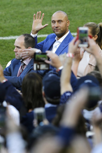 "<div class=""meta image-caption""><div class=""origin-logo origin-image ap""><span>AP</span></div><span class=""caption-text"">Former New York Yankees' Derek Jeter waves to fans during a ceremony retiring his number at Yankee Stadium, Sunday, May 14, 2017, in New York. (AP Photo/Seth Wenig) (AP)</span></div>"