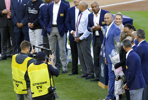 "<div class=""meta image-caption""><div class=""origin-logo origin-image ap""><span>AP</span></div><span class=""caption-text"">Former New York Yankees' Derek Jeter, right, participates in a ceremony retiring his number at Yankee Stadium, Sunday, May 14, 2017, in New York. (AP Photo/Seth Wenig) (AP)</span></div>"