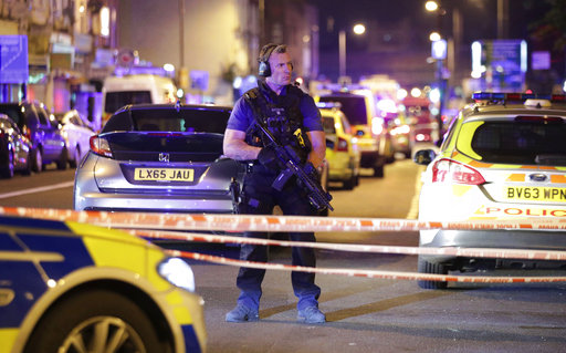"""<div class=""""meta image-caption""""><div class=""""origin-logo origin-image ap""""><span>AP</span></div><span class=""""caption-text"""">An armed police officer mans a cordon on the Seven Sisters Road at Finsbury Park where a vehicle struck pedestrians in London. ((Yui Mok/PA via AP))</span></div>"""
