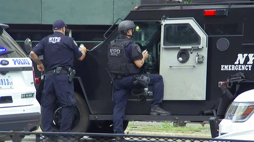 <div class='meta'><div class='origin-logo' data-origin='none'></div><span class='caption-text' data-credit='AP'>New York Police Department Emergency Services officers stand by their armored vehicle outside Bronx Lebanon Hospital.</span></div>
