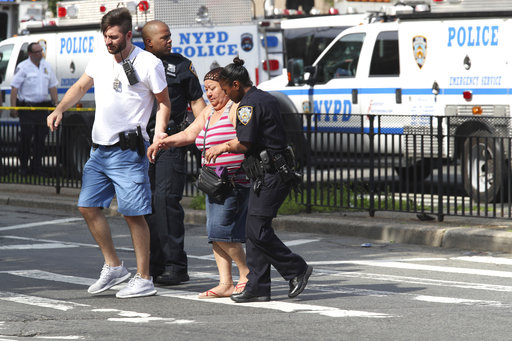 "<div class=""meta image-caption""><div class=""origin-logo origin-image none""><span>none</span></div><span class=""caption-text"">Police help people cross the street outside the Bronx Lebanon Hospital in New York after a gunman opened fire there on Friday, June 30, 2017. (AP Photo/Mary Altaffer)</span></div>"