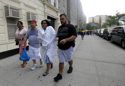 <div class='meta'><div class='origin-logo' data-origin='none'></div><span class='caption-text' data-credit='AP Photo/Julio Cortez'>A woman is escorted by officers in plainclothes near the Bronx Lebanon Hospital in New York after a gunman opened fire there on Friday, June 30, 2017.</span></div>