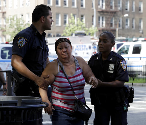 "<div class=""meta image-caption""><div class=""origin-logo origin-image none""><span>none</span></div><span class=""caption-text"">A woman is escorted by officers near the Bronx Lebanon Hospital in New York after a gunman opened fire there on Friday, June 30, 2017. (AP Photo/Julio Cortez)</span></div>"