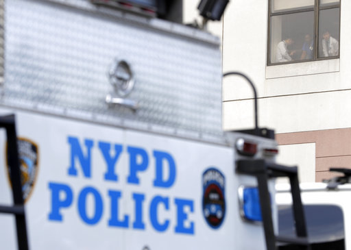<div class='meta'><div class='origin-logo' data-origin='none'></div><span class='caption-text' data-credit='AP Photo/Julio Cortez'>Employees of the Bronx Lebanon Hospital Center look out a window as a New York Police vehicle is seen parked out front.</span></div>
