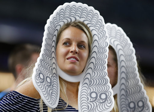 "<div class=""meta image-caption""><div class=""origin-logo origin-image none""><span>none</span></div><span class=""caption-text"">Two women wearing foam judge's wigs watch for New York Yankees Aaron Judge during the late innings against the Milwaukee Brewers in New York, Friday, July 7, 2017. (AP Photo/Kathy Willens)</span></div>"