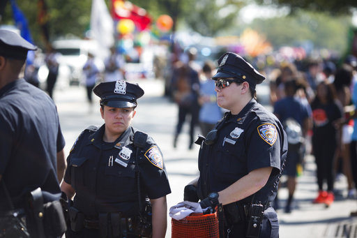 <div class='meta'><div class='origin-logo' data-origin='AP'></div><span class='caption-text' data-credit='Kevin Hagen'>Officers prepare moments ahead of the West Indian Day Parade on Monday, Sept. 4, 2017, in the Brooklyn borough of New York.</span></div>