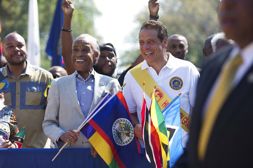 <div class='meta'><div class='origin-logo' data-origin='AP'></div><span class='caption-text' data-credit='Kevin Hagen'>Honorary Grand Marshall Gov. Andrew Cuomo, right, and Rev. Al Sharpton lead the West Indian Day Parade on Monday, Sept. 4, 2017, in the Brooklyn borough of New York.</span></div>