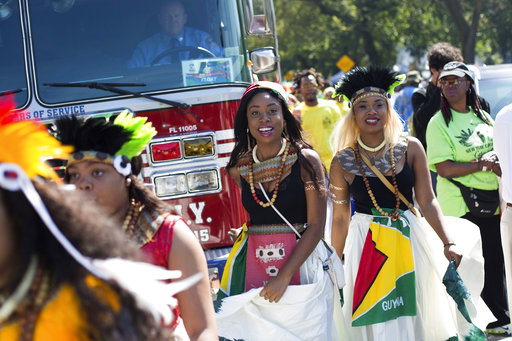 <div class='meta'><div class='origin-logo' data-origin='AP'></div><span class='caption-text' data-credit='Kevin Hagen'>Dancers arrive in costume at the West Indian Day Parade on Monday, Sept. 4, 2017, in the Brooklyn borough of New York.</span></div>