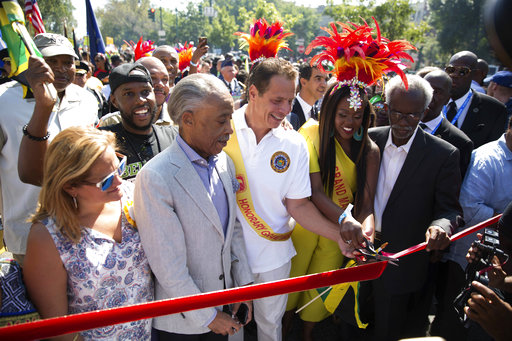 <div class='meta'><div class='origin-logo' data-origin='AP'></div><span class='caption-text' data-credit='Kevin Hagen'>Honorary Grand Marshall New York Gov. Andrew Cuomo and Rev. Al Sharpton lead the West Indian Day Parade on Monday, Sept. 4, 2017, in the Brooklyn borough of New York.</span></div>