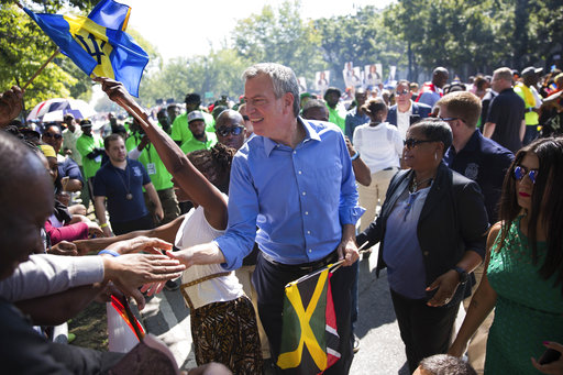 <div class='meta'><div class='origin-logo' data-origin='AP'></div><span class='caption-text' data-credit='Kevin Hagen'>New York Mayor Bill de Blasio greets spectators at the West Indian Day Parade on Monday, Sept. 4, 2017, in the Brooklyn borough of New York.</span></div>