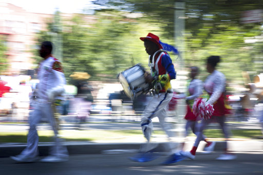 <div class='meta'><div class='origin-logo' data-origin='AP'></div><span class='caption-text' data-credit='Kevin Hagen'>Musicians arrive in costume at the West Indian Day Parade on Monday, Sept. 4, 2017, in the Brooklyn borough of New York.</span></div>