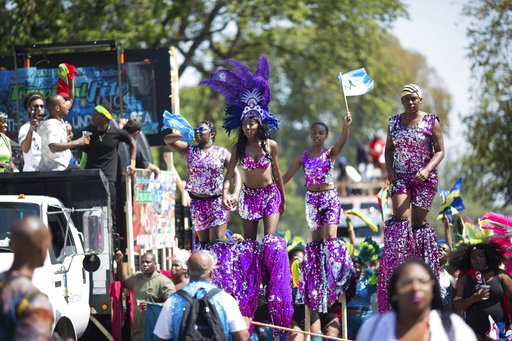 <div class='meta'><div class='origin-logo' data-origin='AP'></div><span class='caption-text' data-credit='Kevin Hagen'>Dancers on stilts perform during the West Indian Day Parade on Monday, Sept. 4, 2017, in the Brooklyn borough of New York.</span></div>