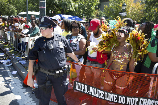 <div class='meta'><div class='origin-logo' data-origin='AP'></div><span class='caption-text' data-credit='Kevin Hagen'>An officer handles a kettle net at an intersection during the West Indian Day Parade on Monday, Sept. 4, 2017, in the Brooklyn borough of New York.</span></div>