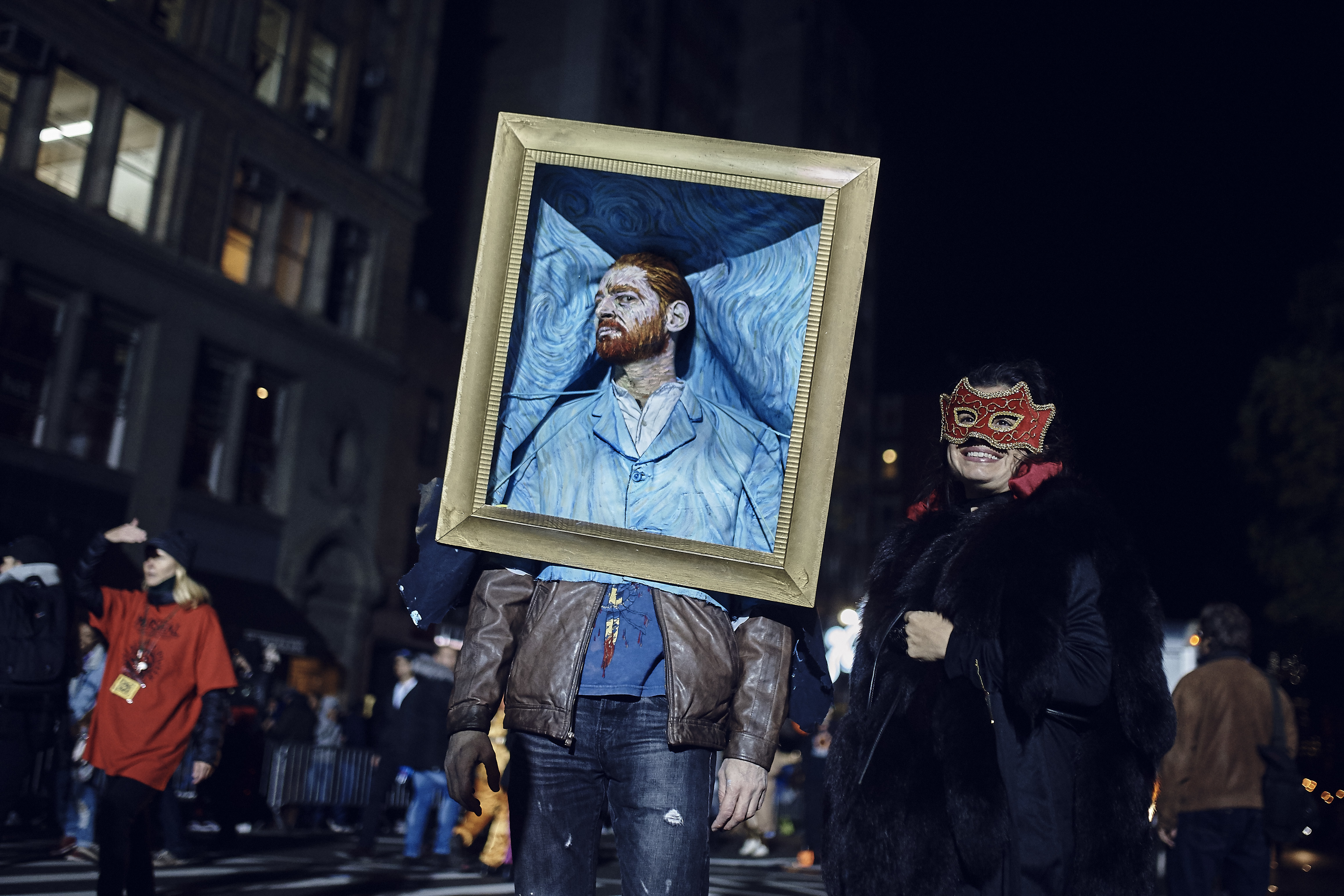 """<div class=""""meta image-caption""""><div class=""""origin-logo origin-image none""""><span>none</span></div><span class=""""caption-text"""">A reveler poses for the photographers during the Greenwich Village Halloween Parade, Tuesday, Oct. 31, 2017, in New York. (AP Photo/Andres Kudacki)</span></div>"""