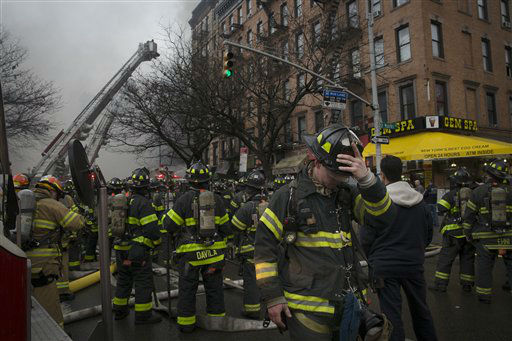 <div class='meta'><div class='origin-logo' data-origin='none'></div><span class='caption-text' data-credit='AP Photo/ John Minchillo'>New York City firefighters work the scene of a large fire and a partial building collapse in the East Village neighborhood of New York on Thursday.</span></div>