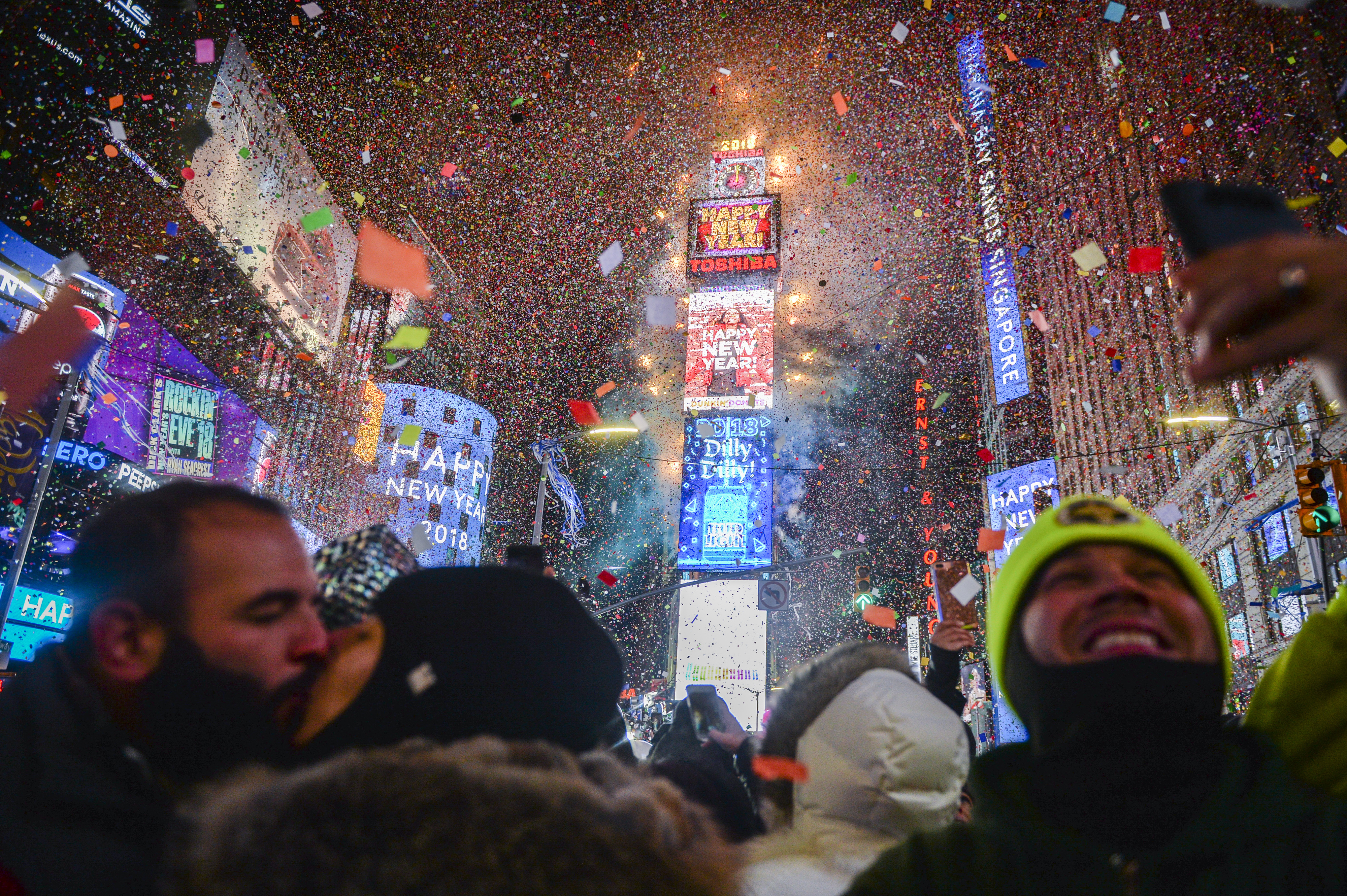 <div class='meta'><div class='origin-logo' data-origin='AP'></div><span class='caption-text' data-credit='Go Nakamura'>People celebrate New Year as confetti fall down after the countdown to midnight in Times Square during New Year's celebrations, Monday, Jan. 1, 2018, in New York.</span></div>