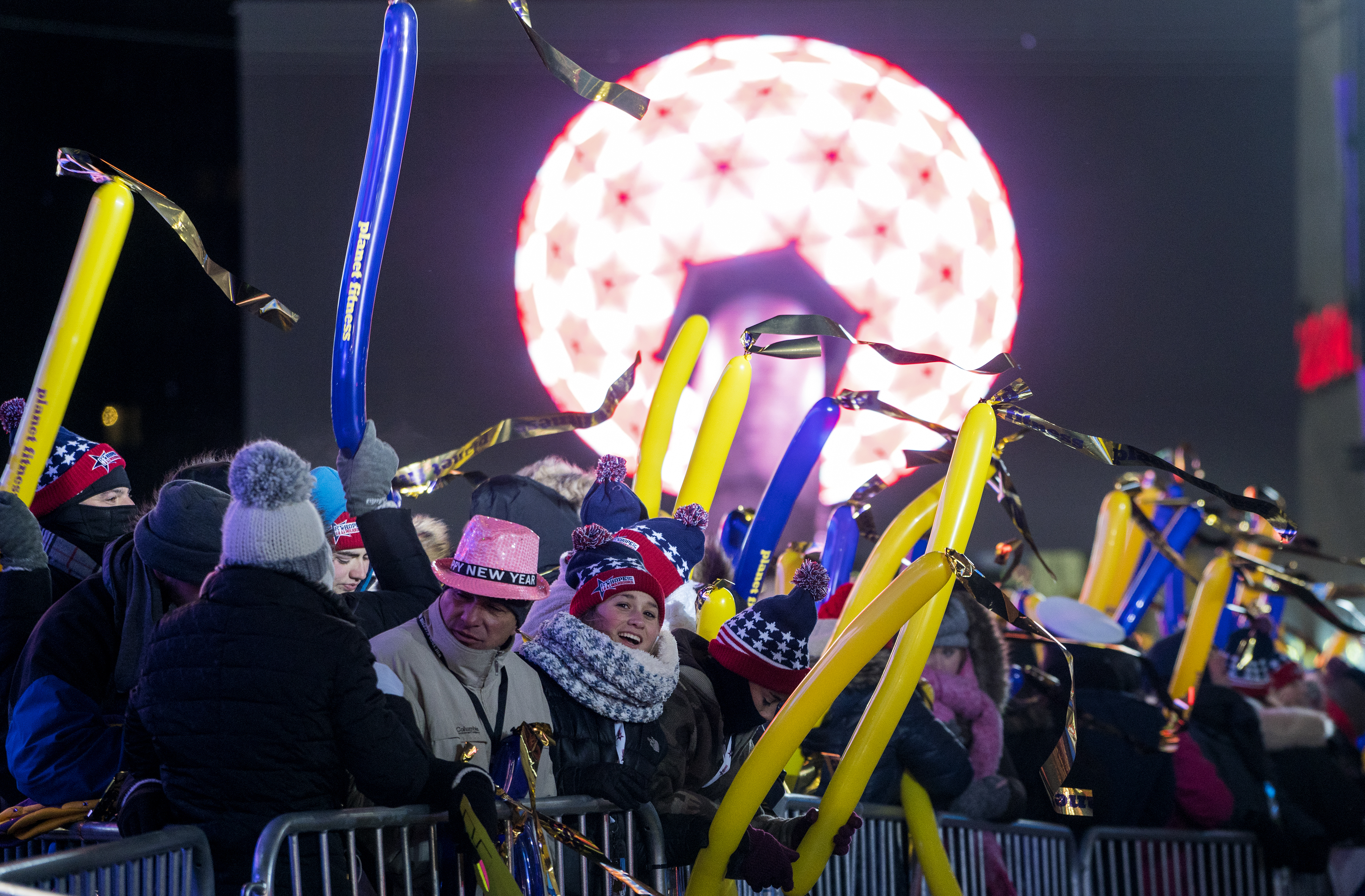 <div class='meta'><div class='origin-logo' data-origin='AP'></div><span class='caption-text' data-credit='AP'>With a television image of the ceremonial ball in the background, revelers gather on Times Square in New York, Sunday, Dec. 31, 2017.</span></div>