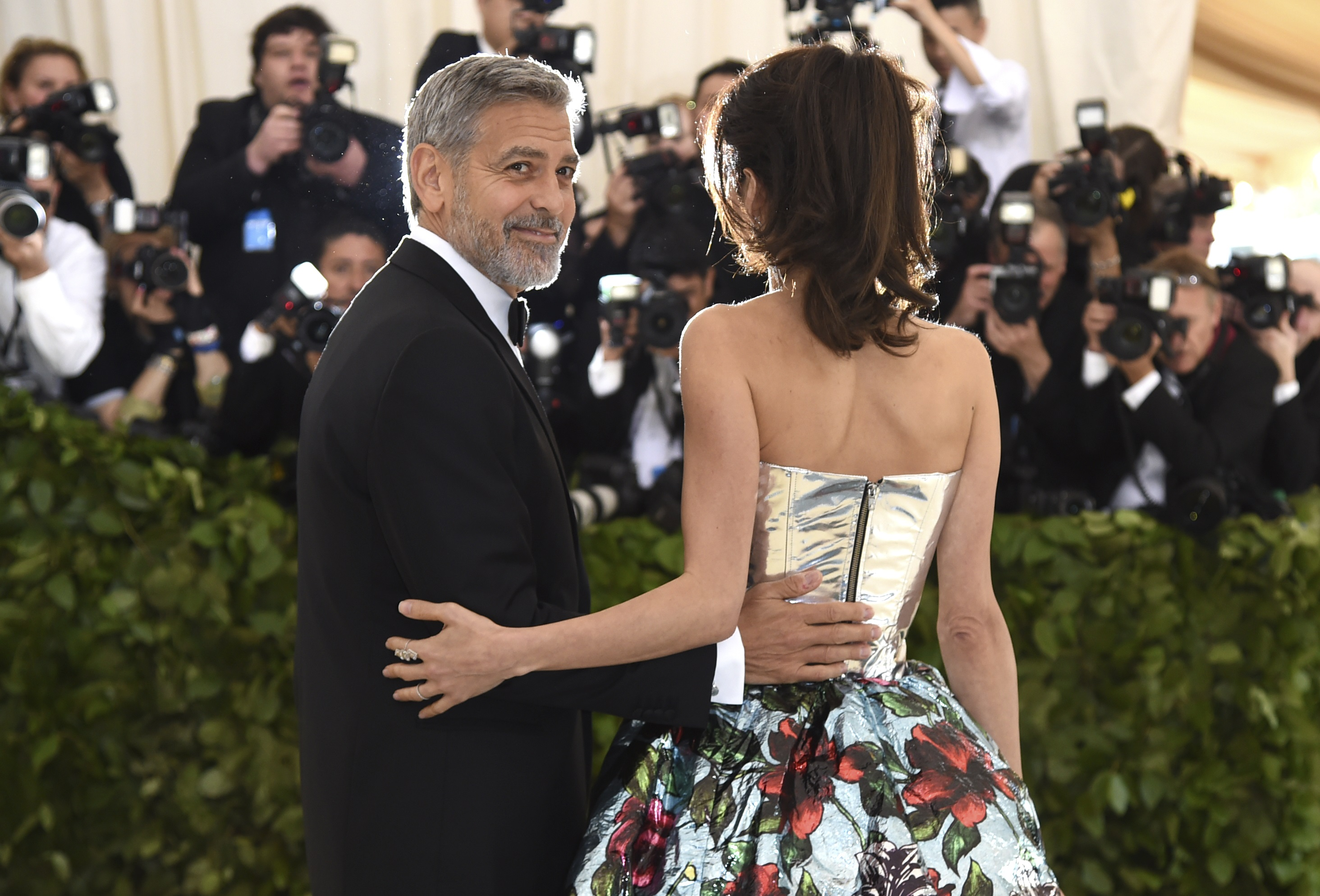 <div class='meta'><div class='origin-logo' data-origin='AP'></div><span class='caption-text' data-credit='Evan Agostini/Invision/AP'>George Clooney, left, and Amal Clooney. (Photo by Evan Agostini/Invision/AP)</span></div>