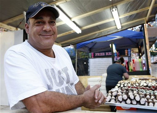"""<div class=""""meta image-caption""""><div class=""""origin-logo origin-image ap""""><span>AP</span></div><span class=""""caption-text"""">Robert Diaz poses with a variety of cannoli while working for a vendor at the Feast of San Gennaro on Mulberry Street in New York's Little Italy neighborhood, Sept. 15, 2016 (AP Photo/Kathy Willens))</span></div>"""