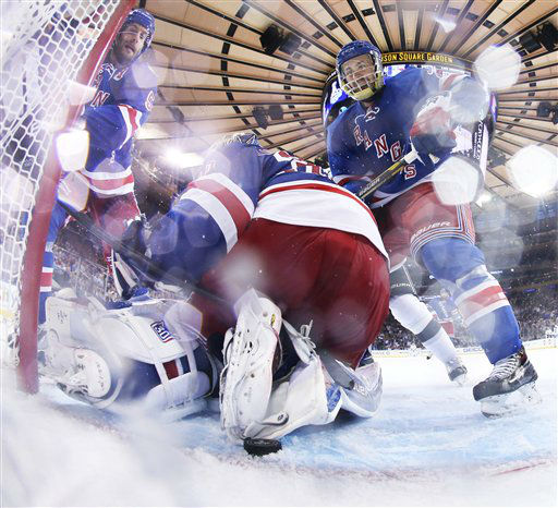 Henrik Lundqvist looks for the puck behind him near the goal line as center Derek Stepan, right, moves in to help in the third period against the Los Angeles Kings during Game 4. <span class=meta>(AP Photo&#47;Bruce Bennett)</span>