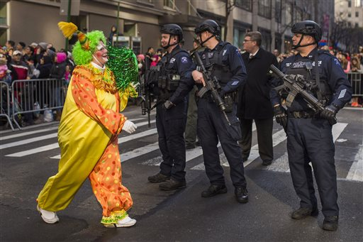 "<div class=""meta image-caption""><div class=""origin-logo origin-image none""><span>none</span></div><span class=""caption-text"">A clown marches by heavily armed police stand guard during the Macy's Thanksgiving Day Parade in New York, Thursday, Nov. 26, 2015. (AP Photo/Andres Kudacki)</span></div>"