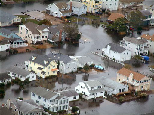<div class='meta'><div class='origin-logo' data-origin='none'></div><span class='caption-text' data-credit='AP Photo/ Randall Chase'>Homes in Bethany Beach, Del. are surrounded by floodwaters from superstorm Sandy on Tuesday, Oct. 30, 2012.</span></div>