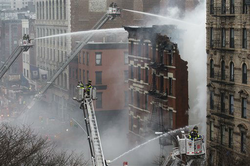 <div class='meta'><div class='origin-logo' data-origin='none'></div><span class='caption-text' data-credit='AP Photo/ John Minchillo'>New York City firefighters work the scene of a large fire and a partial building collapse in the East Village neighborhood of New York on Thursday, March 26, 2015.</span></div>
