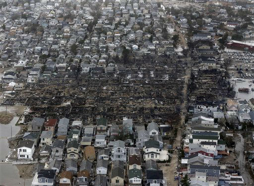 <div class='meta'><div class='origin-logo' data-origin='none'></div><span class='caption-text' data-credit='AP Photo/ Mike Groll'>This aerial photo shows burned-out homes in the Breezy Point section of the Queens borough New York after a fire on Tuesday, Oct. 30, 2012.</span></div>