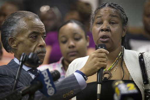 <div class='meta'><div class='origin-logo' data-origin='none'></div><span class='caption-text' data-credit='AP Photo/ John Minchillo'>Esaw Garner, wife of Eric Garner, speaks alongside Rev. Al Sharpton during a service at the Mount Sinai Center for Community Enrichment.</span></div>