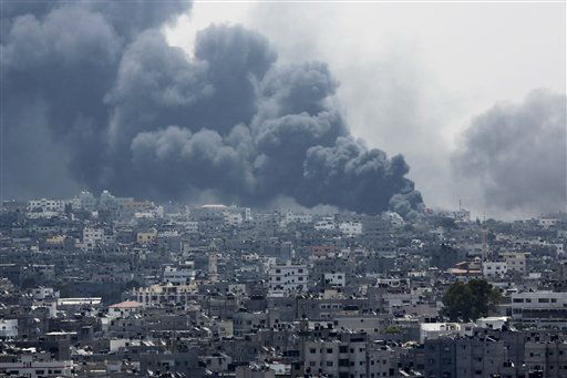 Smoke rises after an Israeli missile hit Shijaiyah neighborhood in Gaza City, northern Gaza Strip, Sunday, July 20, 2014.  <span class=meta>(AP Photo&#47; Adel Hana)</span>