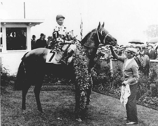"<div class=""meta image-caption""><div class=""origin-logo origin-image none""><span>none</span></div><span class=""caption-text"">Gallant Fox, with jockey Earl Sande up, wears the roses after winning the 1930 Kentucky Derby. Gallant Fox went on to win the Triple Crown. (AP Photo) (AP Photo/ XSS HMB)</span></div>"