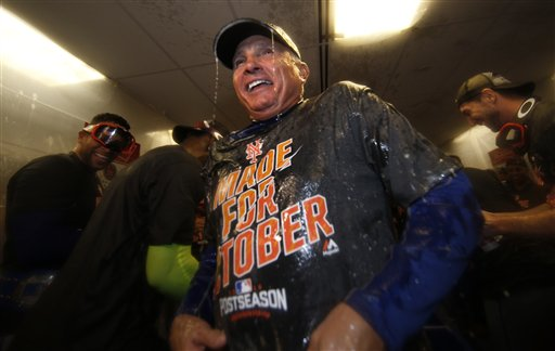 <div class='meta'><div class='origin-logo' data-origin='AP'></div><span class='caption-text' data-credit='AP'>New York Mets manager Terry Colllins is doused with champagne and beer in the clubhouse.</span></div>