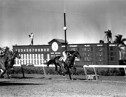 "<div class=""meta image-caption""><div class=""origin-logo origin-image none""><span>none</span></div><span class=""caption-text"">War Admiral approaches the finish line to win the $50,000 Widener Cup at Hialeah racetrack in 1938.  War Admiral was the 1937 Triple Crown winner.  (AP Photo) (AP Photo/ XNBG DD**NY**)</span></div>"
